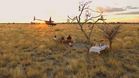 Exclusive sundowners in the Kalahari wilderness