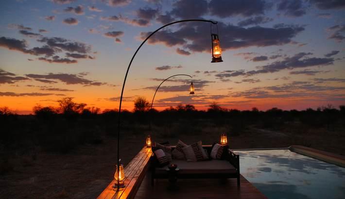 Watching a Kalahari sunset from the pool
