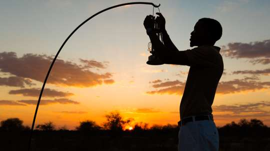 Lighting a lantern at sunset