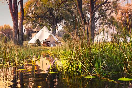 Mbudi mobile safari tents on the river bank