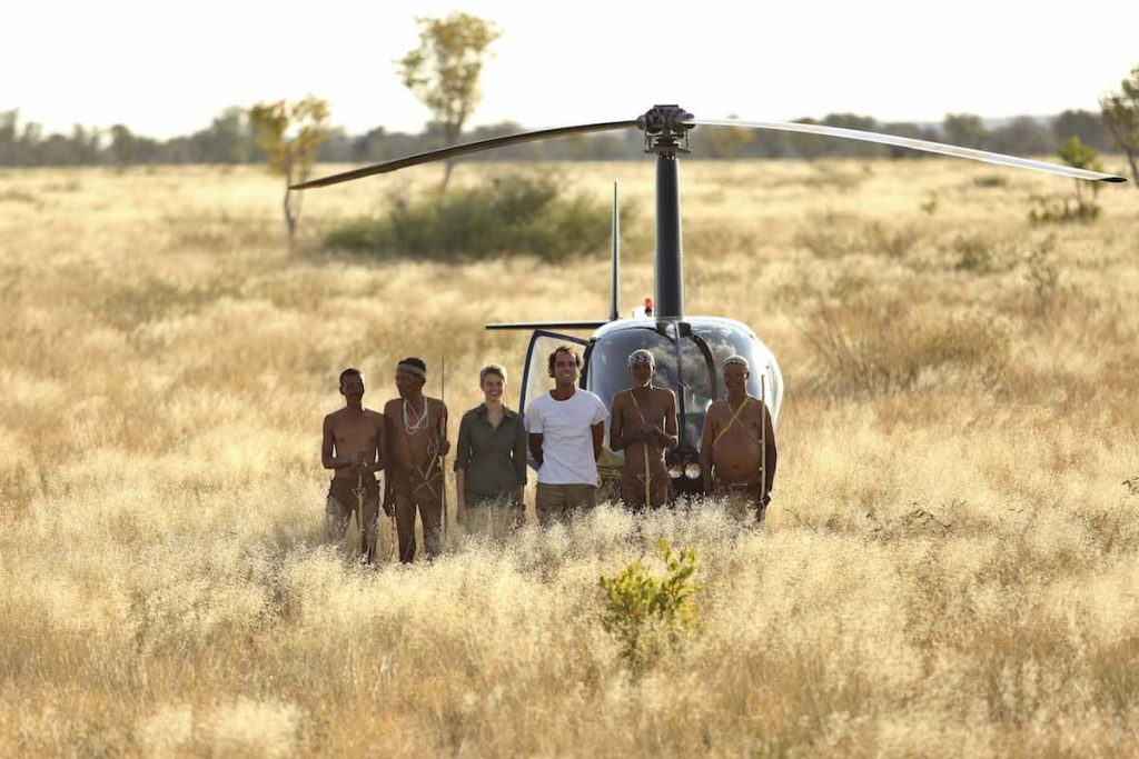 Bushmen, guests and helicopter